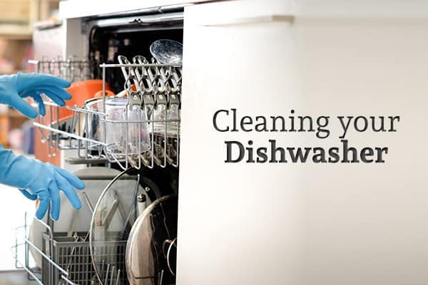 "A person wearing gloves reaches into a dishwasher full of dishes beside the words ""Cleaning your Dishwasher"""