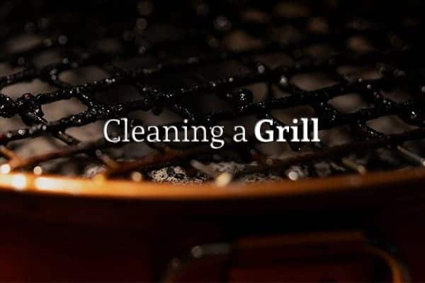 "A close up of the edge of a grill beneath the words ""Cleaning a Grill"""